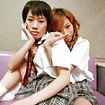 Japanese twin sisters do school girl cosplay - image