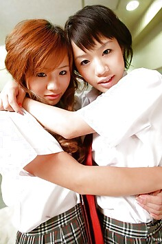 Japanese twin sisters do school girl cosplay