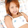Perky tits young Thai model - image