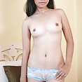 Sweet filipina lbfm squeezes her tiny tits together - image