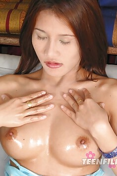 Busty Thai girl gets a sticky titty cum shot