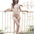 Mila Jade shows off her teen asian nude body by the pool - image