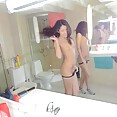 Skinny Chinese girl can see her ass in the mirror - image