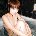 Cute tits on this Japanese nude girl in the shower - image