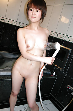 Cute tits on this Japanese nude girl in the shower