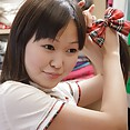 Chinese webcam girl gets dressed in her schoolgirl Cosplay costume - image